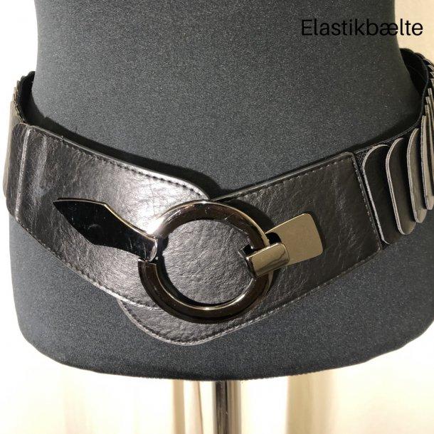 Bælte med rundt spænde og vifter elastisk